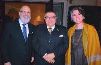 Ambassador of Uruguay, Alvaro A. Malmierca (Left)  with High Commissioner of Cyprus, Agis Loizou presenting (centre) and Mrs. Mariana Wainstein (Right) spouse of the Ambassador of Uruguay.